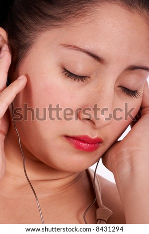A pretty young lady listening to music