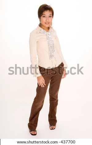 A pretty young Malay girl in beige and brown casual clothes