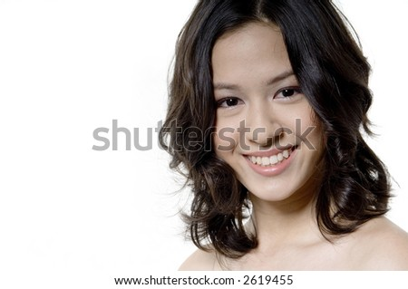 A pretty young teenage woman on white background