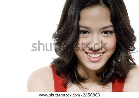 A pretty young teenager in red top on white background