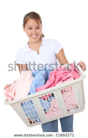 A pretty young woman doing laundry at home - stock photo
