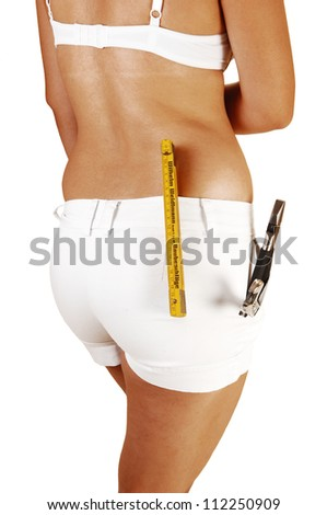 A pretty young woman from the back in white shorts and bra with some tools in her shorts on the way to fix the problem, on white background. - stock photo