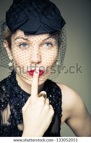 A pretty young woman in a black outfit making a decision - stock photo