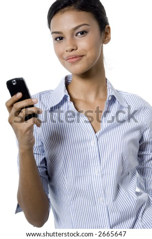 A pretty young woman in striped blouse holding a mobile phone on white background