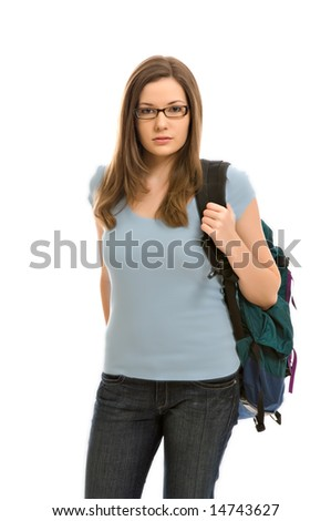 A pretty young woman, isolated against a white background, carries her books in a backpack - stock photo