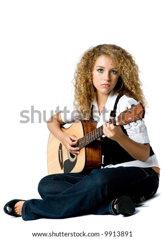 A pretty young woman playing acoustic guitar on white background - stock photo