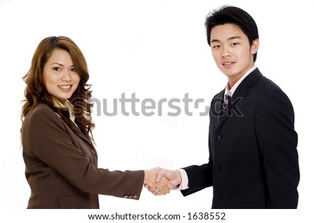 A pretty young woman shakes hands with a young businessman