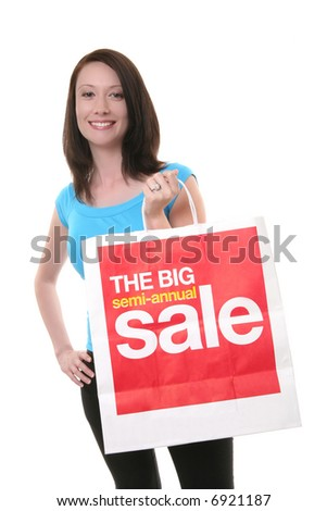 A pretty young woman shopping with a large sale bag - stock photo