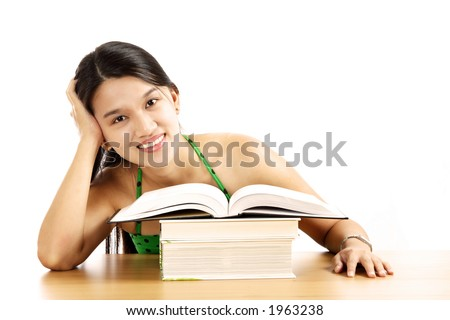 A pretty young woman sitting with an opened book