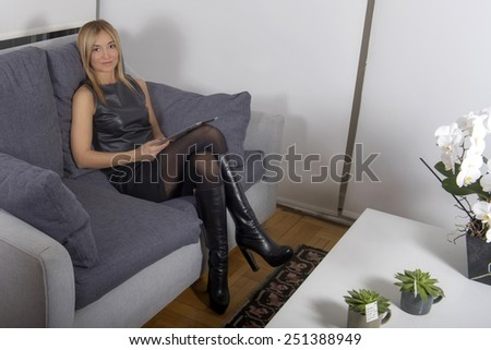 A pretty young woman using a digital tablet - stock photo
