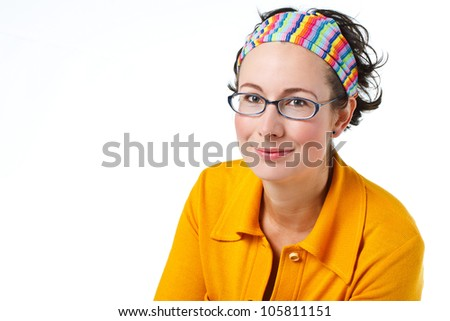 A pretty young woman wearing glasses,a colorful, striped headband, black top and yellow sweater, smiling into camera - isolated on white