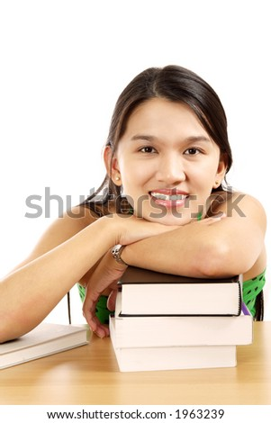 A pretty young woman with a stack of books