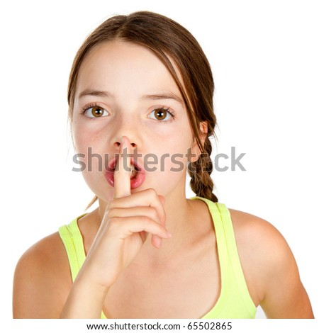A primary aged girl with her finger on her lips making a shush or shh gesture.