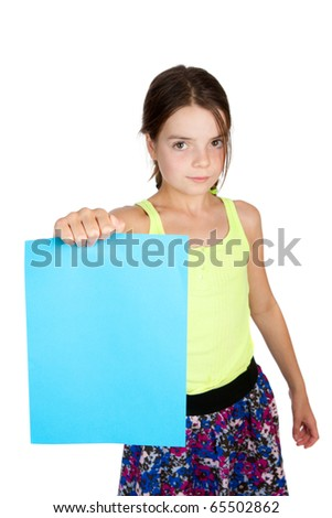 A primary aged girld holding a sheet of paper at arms length.  Differential focus on the paper.