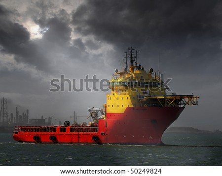 A primary function of a platform supply vessel is to transport supplies to the oil platform and return other cargoes to shore - stock photo