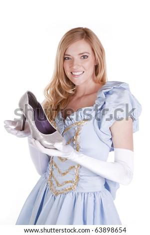 A princess is holding a shoe in her hands. - stock photo