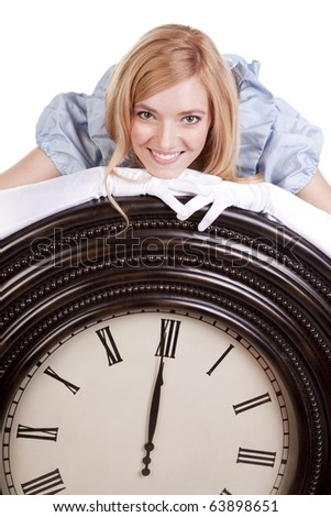 A princess is leaning on a big clock.  She is smiling. - stock photo