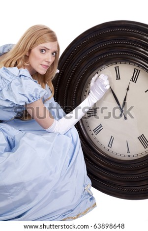A princess is trying to change the time on a big clock. - stock photo