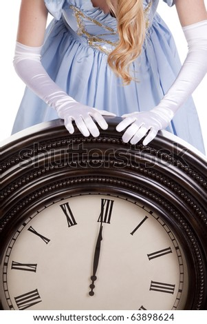 A princess with a big clock pointing to midnight. - stock photo