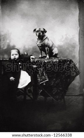 A print from a glass negative taken in an an old view camera about 1890. A young child with dog - stock photo