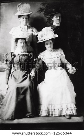 A print from a glass negative taken in an an old view camera about 1890. Portrait of three ladies in great hats. - stock photo