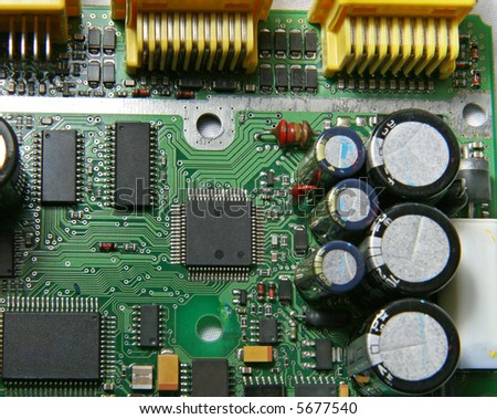 A printed circuit board with various electronic devices mounted on it.