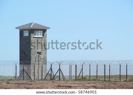 A prison guard tower, photograph taken from inside the prison. - stock photo