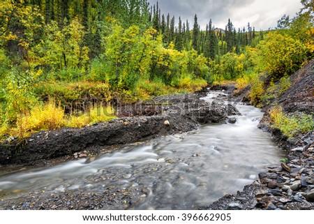 A pristine mountain stream near the Denali highway in Alaska. - stock photo