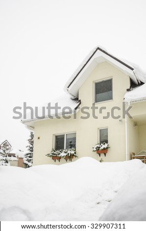 a private house under snow - stock photo