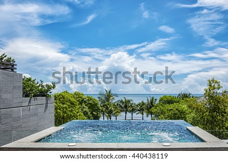 A private jacuzzi overlooks the ocean at a health spa resort in Hua Hin, Thailand. - stock photo