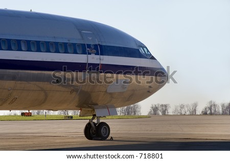 A private jet is parked on the tarmac. - stock photo