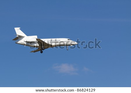 A private jet without any sign landing at Vienna airport - stock photo