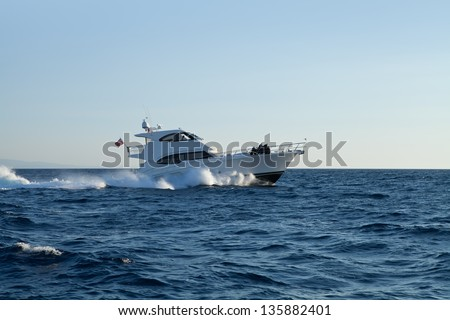 A private motor yacht under way out at sea