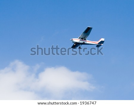 A private plane in the sky - stock photo