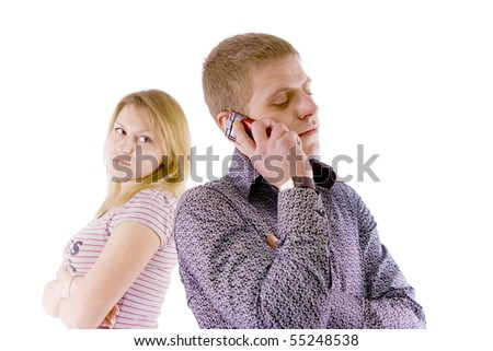 A problem of young families. Man talking on the phone, forgetting about his wife - stock photo
