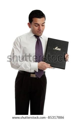 A professional businessman, waiter, restauranteur holding and presenting a black leatherbound folder. - stock photo