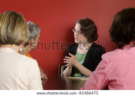 A professional counselor leads discussion and offers advice in a women's workshop - stock photo