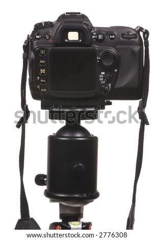 A professional digital camera DSLR on a tripod - stock photo