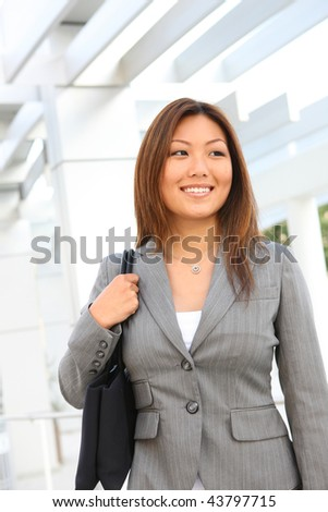 A professional pretty asian business woman at the office - stock photo
