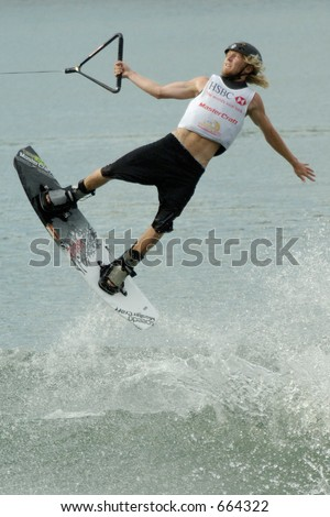 A professional wakeboarder jumps off the wake