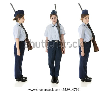A profile, front and face right view of a Jr. ROTC teen in uniform with her rifle.  On a white background. - stock photo
