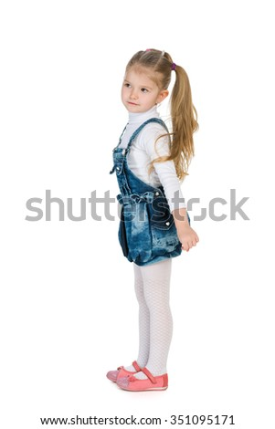 A profile portrait of a fashion little girl on the white background
