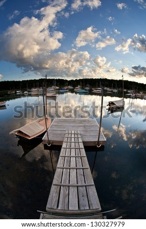 A protected saltwater pond in Pleasant Bay, Cape Cod, is used by sailboat owners as an anchorage.  Cape Cod is a popular area for the sport of sailing. - stock photo