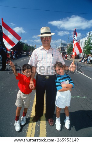 A Puerto Rican father with his sons at the Puerto Rican Festival, Wilmington, DE - stock photo