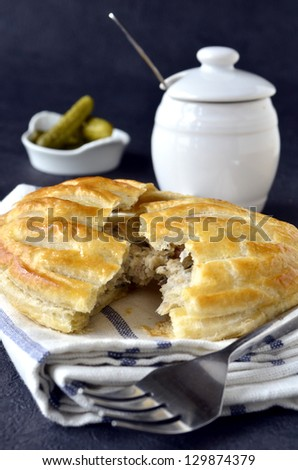 A puff pastry savoury filled lattice pie - stock photo