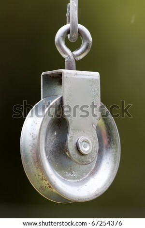 a pulley hanging on the wire garden - stock photo