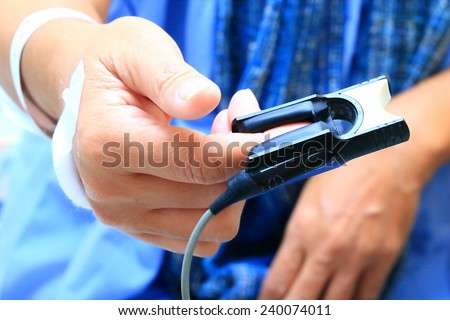 A pulse oximeter used to measure pulse rate and oxygen levels - stock photo