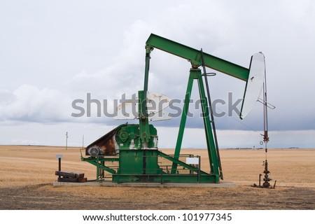 A pumpjack in Alberta, Canada. - stock photo