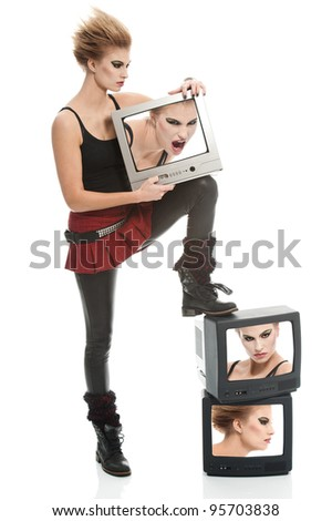 a punk girl posing with tv sets - stock photo
