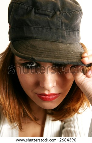 A punkish girl looks out with a flirtatious expression. - stock photo